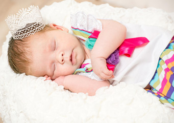 newborn girl with a crown