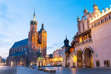 Sukiennice and St. Mary's Church at night in Krakow, Poland.