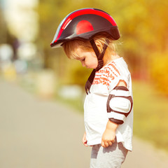 two year old in  a helmet