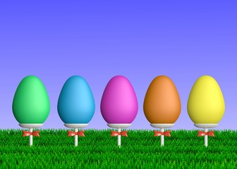 Colorful Easter Eggs on Sticks in Grass