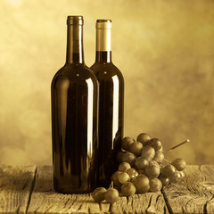 Wine bottles on wood floor and grunge background