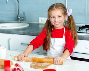 little girl preparing cookies