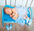 canvas print picture - newborn baby sleeps in a small bed