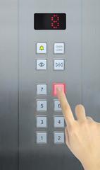 hand press 8 floor in elevator