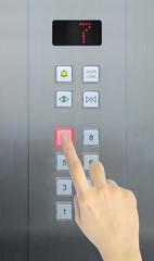 hand press 7 floor in elevator