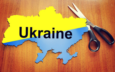 Map of Ukraine and scissors. Concept of dividing the country