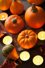 decorative halloween pumpkins and candles