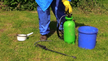 Farmer man prepare pesticides chemicals for plant spray