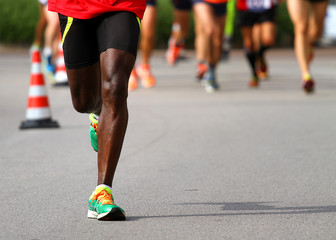 athlete runs down the street during the race outdoors