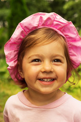 Summer portrait of сгеу little baby girl laughing