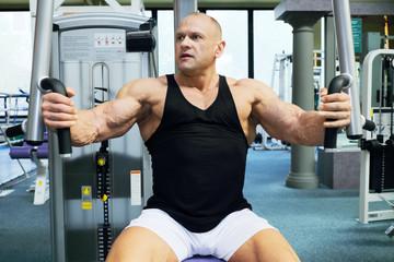 Handsome bodybuilder in black jersey trains