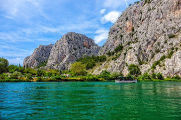 Tourist boat on the River Cetina in Omis, Croatia.