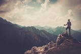Fototapety Woman hiker on a top of a mountain