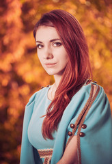 redhead woman in vintage style dress