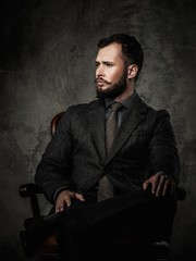 Handsome well-dressed  sitting in leather chair