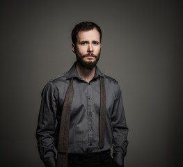 Handsome man with beard with a tie