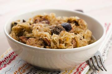 traditional polish sauerkraut (bigos) with mushrooms and plums