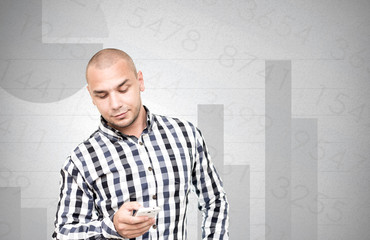 Businessman checks the financial analysis on smartphone