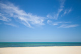 Fototapety Beautiful cloudy sky over white sandy beach. Nature background