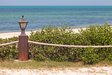 Beach border railing with rope and light