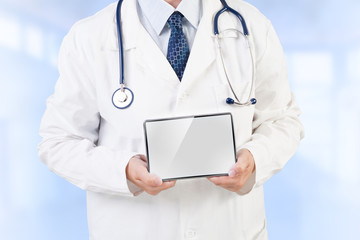 Doctor holding tablet with copy space