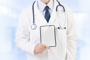 Doctor with copy space on tablet