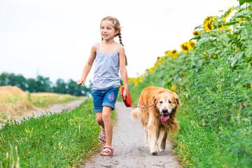 Little girl with golden retriever