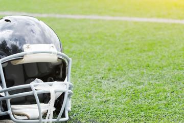 American football helmet on a empty field.