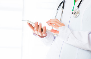 Doctor's hands with mobile phone