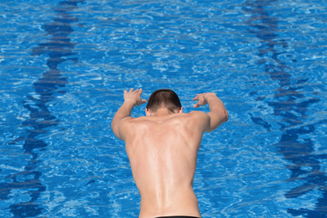 Swimmer jumping into the pool.