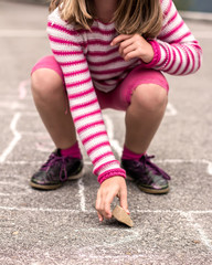 Child on the hopscotch