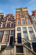 Facades of colorful living houses in Amsterdam, Netherlands