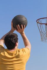 Basketball recreation on a outdoor court.