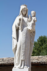 old cemetery sculpture of the Virgin