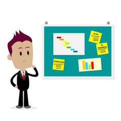 Man Looking At Office Bulletin Board