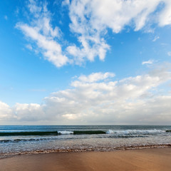 Atlantic ocean coast with bright cloudy sky