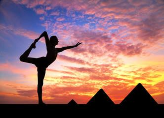 Yoga near Egyptian Pyramids