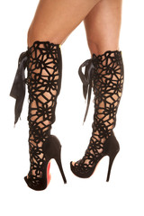 woman in lace up printed boots