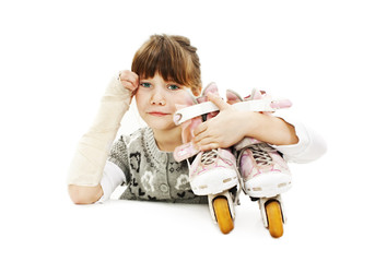 Little Girl with roller skates and broken arm