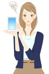 スマートフォンを持つ女性 悲しい