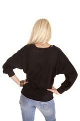 woman hands on hips ling sleeve top
