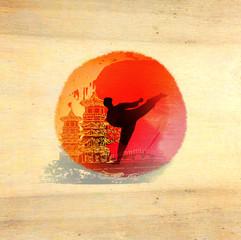 karate man - wooden background