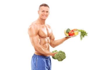 Bodybuilder holding a broccoli dumbbell and a plate