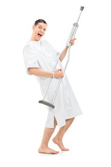 Patient playing on a crutch and dancing