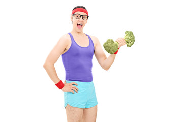 Nerdy guy holding a broccoli dumbbell