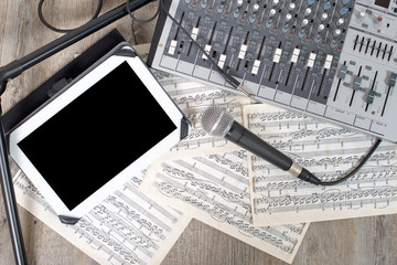 digital tablet placed on a audio mixer