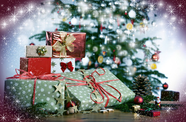 Christmas gifts in front of Christmas tree and stars