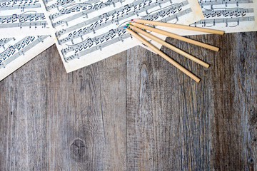 musical scores with pencils on a table