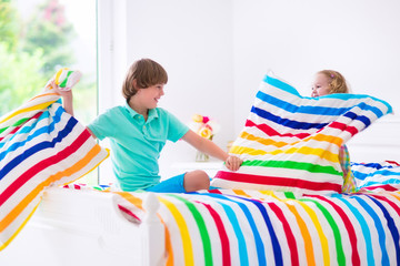 Happy kids having pillow fight