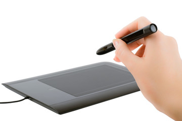 Woman's hand holding a pen to draw on the tablet